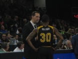 NKU head coach John Brannen talks with Holland II after the guard was assessed a technical foul in the second half.